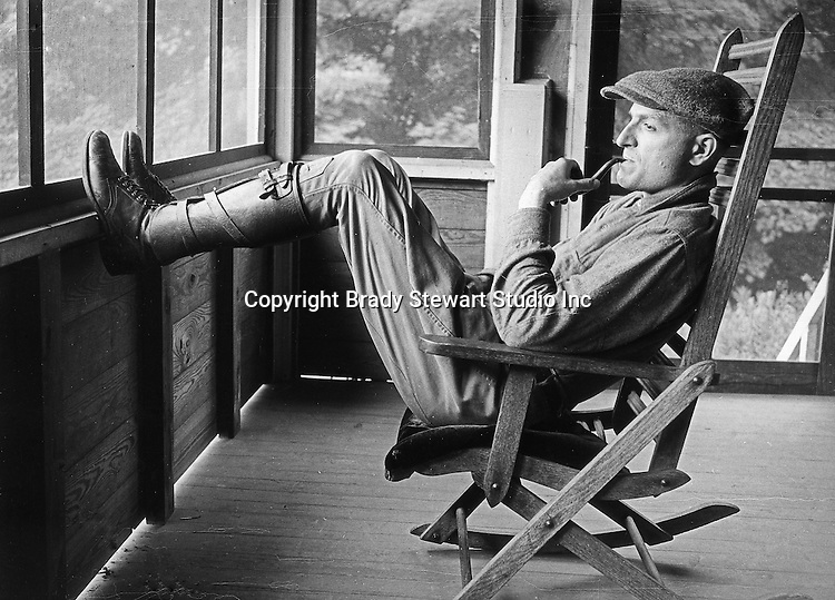 North East PA:  Brady Stewart relaxing in a rocking chair during a rainstorm - 1919.  This was the Stewart family's first Lake Erie vacation after Brady Stewart served his country during World War 1.  Stewart family rented a cabin on Lake Erie near North East.