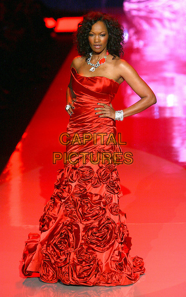 GARCELLE BEAUVAIS-NILON.The Heart Truth Fall 2011 fashion show during Mercedes-Benz Fashion Week at The Theatre at Lincoln Center on New York City, New York, NY, USA,.9th February 2011..catwalk runway model modeling full length red dress long maxi strapless hands on hips ruched silk satin flowers roses .CAP/ADM/PZ.©Paul Zimmerman/AdMedia/Capital Pictures.