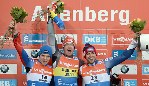 13.02.2016. Altenberg, Germany.  2nd-place Roman Repilov (Russia, L-R), victor Felix Loch (Germany), and third-place Chris Mazdzer   (USA) celebrate at the victory ceremony after the men's singles at the Luge World Cup  in Altenberg, Germany, 13 February 2016.