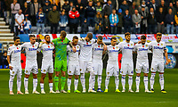 The Leeds United team observe a minutes silence before the match<br /> <br /> Photographer Alex Dodd/CameraSport<br /> <br /> The EFL Sky Bet Championship - Wigan Athletic v Leeds United - Sunday 4th November 2018 - DW Stadium - Wigan<br /> <br /> World Copyright &copy; 2018 CameraSport. All rights reserved. 43 Linden Ave. Countesthorpe. Leicester. England. LE8 5PG - Tel: +44 (0) 116 277 4147 - admin@camerasport.com - www.camerasport.com