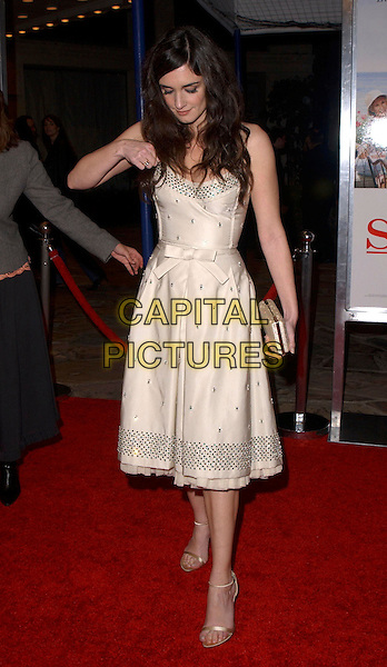 "PAZ VEGA .attends Columbia Pictures' Los Angeles Premiere of ""Spanglish"" held at The Mann's Village Theatre in Westwood, California, USA,December 9th 2004..full length cream fifties style prom dress bow.Ref: DVS.www.capitalpictures.com.sales@capitalpictures.com.©Capital Pictures."