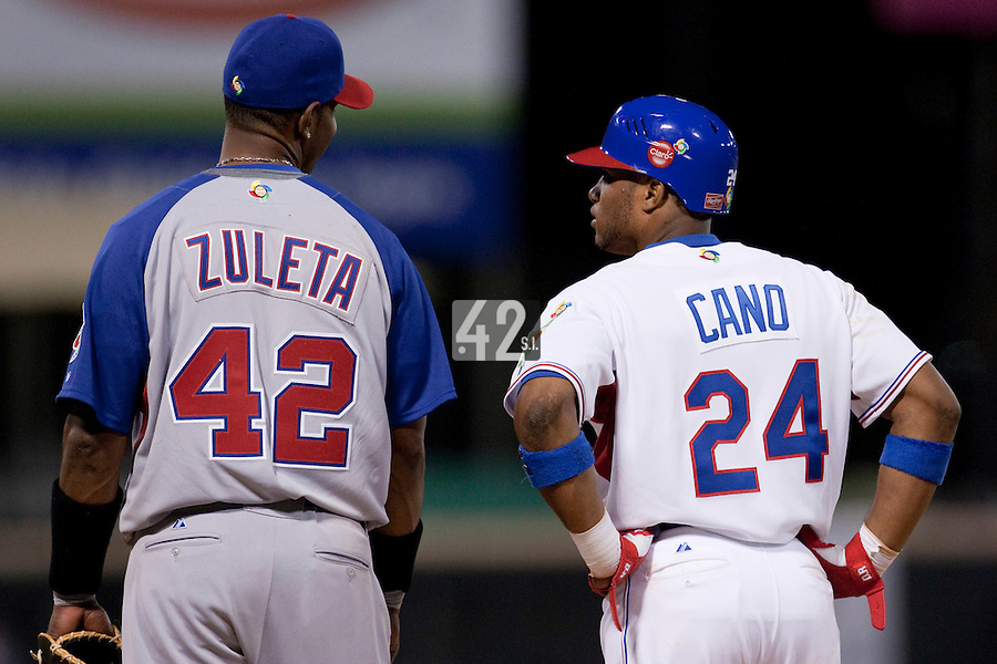 8 March 2009: #42 Julio Zuleta of Panama talks to #24 Robinson Cano of Dominican Republic during the 2009 World Baseball Classic Pool D match at Hiram Bithorn Stadium in San Juan, Puerto Rico. Dominican Republic wins 9-0 over Panama.