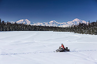 Man on snomobile on a lake with Mt. Mckinley and Alaska Range in the background.   Southcentral, Alaska<br /> <br /> MR2013-03-23BuserMartin /