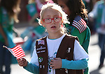 Mia Colonna, 8, marches with Carson City Girl Scouts in the annual Veterans Day parade in Virginia City, Nev., on Monday, Nov. 11, 2013.<br /> Photo by Cathleen Allison