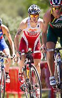 02 JUN 2013 - MADRID, ESP - Kyle Jones (CAN) (centre) of Canada on the bike during the men's ITU 2013 World Triathlon Series round in Casa de Campo, Madrid, Spain (PHOTO (C) 2013 NIGEL FARROW)