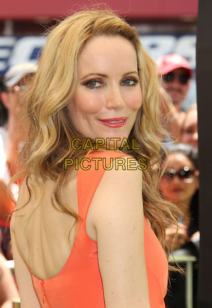 "Leslie Mann.""ParaNorman"" Los Angeles Premiere held at AMC CityWalk Stadium 19 Theatre, Universal City, California, USA..August 5th, 2012.headshot portrait orange  side looking over shoulder .CAP/ADM/RE.©Russ Elliot/AdMedia/Capital Pictures."