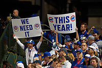 Chicago Cubs fans hold up signs in the eighth inning during Game 3 of the Major League Baseball World Series against the Cleveland Indians on October 28, 2016 at Wrigley Field in Chicago, Illinois.  (Mike Janes/Four Seam Images)