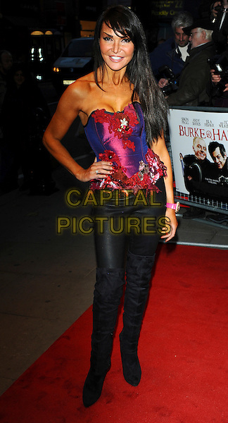 LIZZIE CUNDY .Attends the 'Burke and Hare' World Premiere at The Chelsea Cinema, Kings Road, Chelsea, London, England, UK, 25th October 2010..full length pink corset top black trousers hand on hip tanned red pink bustier .CAP/CJ.©Chris Joseph/Capital Pictures.