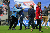 A Wembley steward tries to stop a fan running any further onto the pitch at the end of the match during Bradford City vs Millwall, Sky Bet EFL League 1 Play-Off Final at Wembley Stadium on 20th May 2017