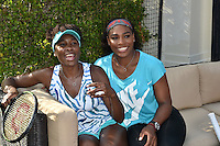 KEY BISCAYNE, FL - MARCH 24: Venus Williams, Serena Williams at the Sixth Annual Ritz-Carlton Key Biscayne, Miami All-Star Charity Tennis Event at the Ritz Hotel on March 24, 2014 in Key Biscayne, Florida.<br /> <br /> <br /> People:  Venus Williams, Serena Williams<br /> <br /> Transmission Ref:  FLXX<br /> <br /> Must call if interested<br /> Michael Storms<br /> Storms Media Group Inc.<br /> 305-632-3400 - Cell<br /> 305-513-5783 - Fax<br /> MikeStorm@aol.com