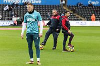 (L-R) Alfie Mawson warms up with Swansea City assistant manager Gary Richards and Swansea manager Paul Clement prior to the game during the Premier League match between Swansea City and Crystal Palace at The Liberty Stadium, Swansea, Wales, UK. Saturday 23 December 2017