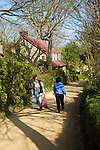 Women walking along village street Island of Sark, Channel Islands, Great Britain