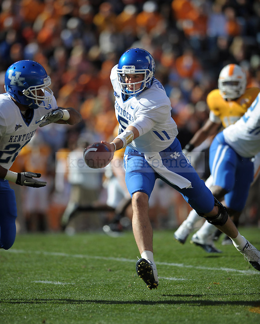 Kentucky Wildcats quarterback Mike Hartline hands the ball to running back Derrick Locke during the first half of the University of Kentucky's game against Tennessee at Neyland Stadium in Knoxville, Tn., on 11/27/10. UK lost the game 24-14. Photo by Mike Weaver | Staff