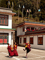 Buddhist student monks playing soccer or football at a monastery in Sikkim, India