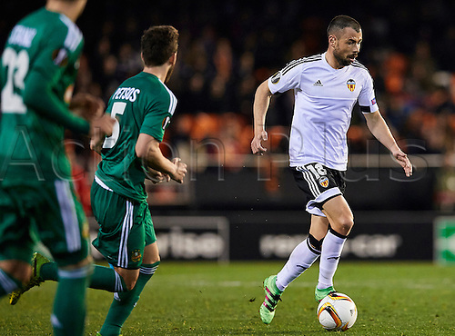 18.02.2016. Mestalla Stadium, Valencia, Spain. Europa League. Valencia versus Rapid Wien. Midfielder Javi Fuego of Valencia CF (R) is challenged by Midfielder Thanos Petsos of Rapid