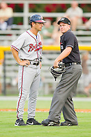 Danville Braves manager Jonathan Schuerholz (2) is ejected for arguing a call with home plate umpire Drew Freed during the game against the Burlington Royals at Burlington Athletic Park on July 18, 2012 in Burlington, North Carolina.  The Royals defeated the Braves 4-3 in 11 innings.  (Brian Westerholt/Four Seam Images)