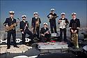 Major Pierre Cano / Trompette<br /> Maître principal Charles Renaud / Wash Board<br /> Premier maître Guy Duverget : Trombone<br /> Premier maître Christophe Criado / Banjo<br /> Maître Ferjeux Beauny / Saxophone<br /> Second maître Sylvain Therond / Clarinette<br /> Maître Vincent Ollier / Tuba<br /> LES MUSICIENS DE LA FLOTTE