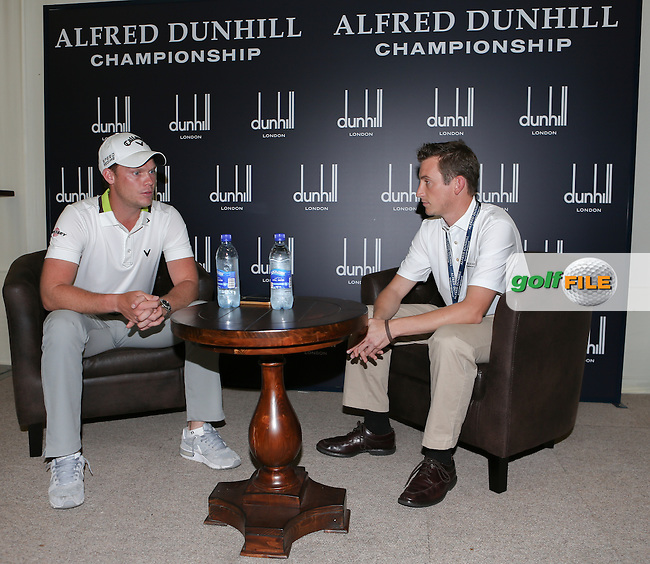The 2014 Nedbank Golf Challenge Champion Golfer Danny Willett (ENG) being interviewed by Mike Taylor of the Sunshine Tour during the practice day ahead of 2014 Alfred Dunhill Championship at the Leopard Creek Country Club, Malelane, Mpumalanga, South Africa. Picture:  David Lloyd / www.golffile.ie