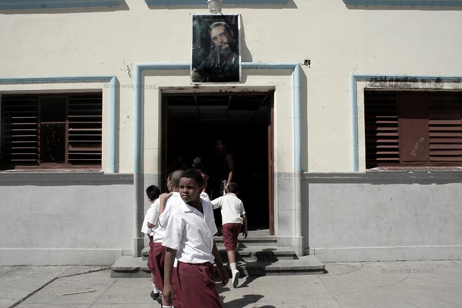 Havana (Cuba). September 2006..La Habana Vieja. Public School with Fidel Castro's portrait..