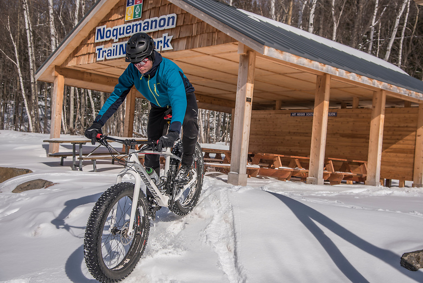 Fatbiking at the Noquemanon Trails Network South Trails trailhead in winter at Marquette, Michigan.
