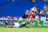 Tom Savage of Gloucester Rugby drives through the tackle of Jonathan Joseph and Scott Lawson of London Irish during the Aviva Premiership match between London Irish and Gloucester Rugby at the Madejski Stadium on Saturday 8th September 2012 (Photo by Rob Munro)
