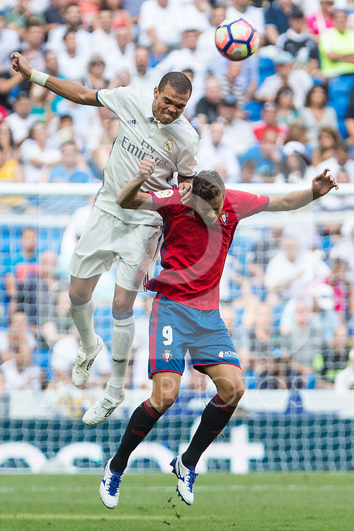Real Madrid's Pepe and Club Atletico Osasuna's Oriol Riera during the match of La Liga between Real Madrid and Club Atletico Osasuna at Santiago Bernabeu Estadium in Madrid. September 10, 2016. (ALTERPHOTOS/Rodrigo Jimenez)