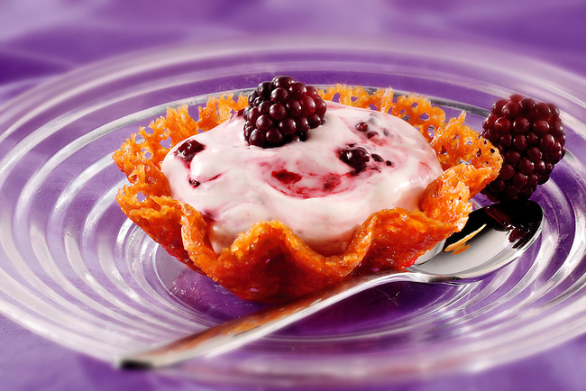 Blackberry mousse ina brandy snap basket