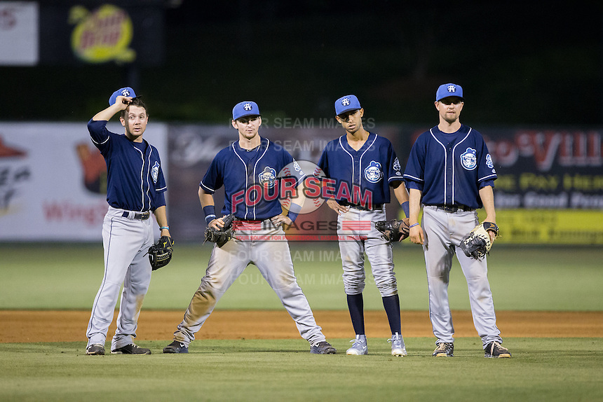 (L-R) Max George (3), Brendan Rodgers (1), Carlos Herrera (4), and Brian Mundell (15) wait for the new pitcher to complete his warm-up tosses during the game against the Kannapolis Intimidators at Intimidators Stadium on May 28, 2016 in Kannapolis, North Carolina.  The Intimidators defeated the Tourists 5-4 in 10 innings.  (Brian Westerholt/Four Seam Images)