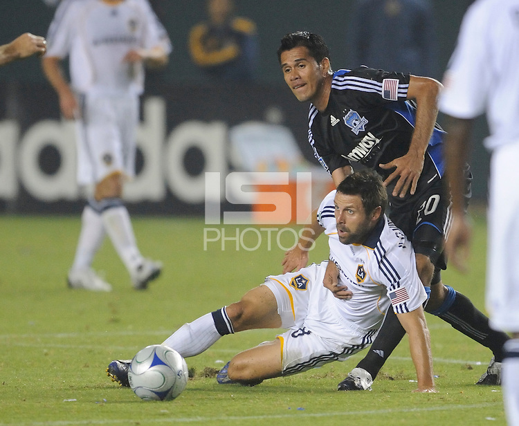 Los Angeles Galaxy's Dema Kovalenko and San Jose Earthquakes Ramon Sanchez fight for the ball at the Home Depot Center. Los Angeles Galaxy beat San Jose 2-0 Saturday, October 24. 2009, in Carson, California.