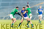 Denis Daly Kerry in action against James Bridgeman and Iain Corbett Limerick in the Final of the McGrath Cup at the Gaelic Grounds on Sunday.