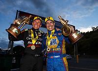 Jun 18, 2017; Bristol, TN, USA; NHRA top fuel driver Clay Millican (left) celebrates alongside funny car driver Ron Capps after winning the Thunder Valley Nationals at Bristol Dragway. Mandatory Credit: Mark J. Rebilas-USA TODAY Sports