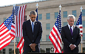 United States President Barack Obama and U.S. Secretary of Defense Chuck Hagel bow their heads during a ceremony at the Pentagon to mark the 13th anniversary of the September 11th, 2001 terrorist attacks, in Washington, Thursday, September 11, 2014.<br /> Credit: Martin Simon / Pool via CNP