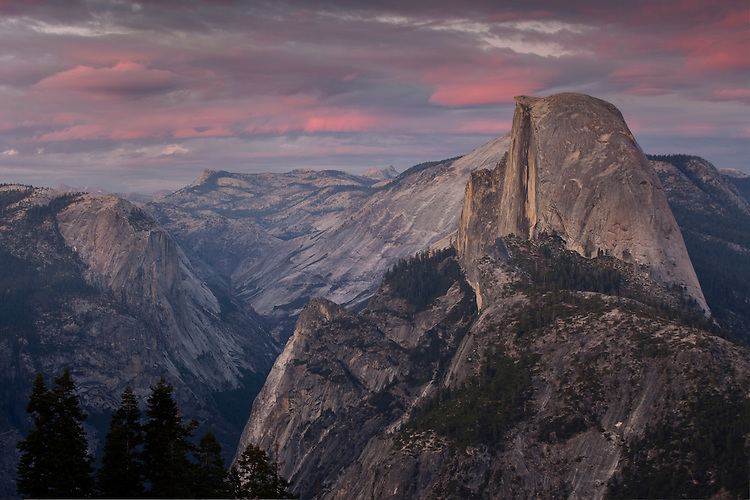 Sunset colors illuminate the back country and Half Dome in Yosemite NP, California