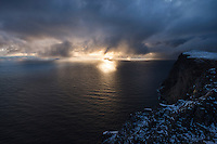 Sun hidden behind heavy clouds from summit of Ryten, Moskenesøy, Lofoten Islands, Norway