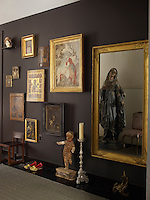 The walls of the entrance hall are decorated with a collection of artworks which include Russian icons and a 17th century Italian painting
