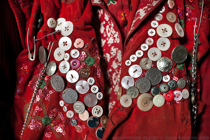 Detail of a young Kyrgyz's girl daily cloth. It includes old coins, safety pins, any type of shiny objects, buttons etc ..Trekking with yak caravan through the Little Pamir where the Afghan Kyrgyz community live all year, on the borders of China, Tajikistan and Pakistan.