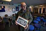 Glossop North End director Stewart Taylor showing off an archive photograph of Glossop North End in the clubhouse of the club's Surrey Street ground before their game with Barnoldswick Town in the Vodkat North West Counties League premier division. The visitors won the match by one goal to nil watched by a crowd of 203 spectators. Glossop North End celebrated their 125th anniversary in 2011 and were once members of the Football League in England, spending one season in the top division in 1899-00.