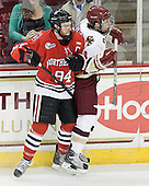 Tyler McNeely (Northeastern - 94), Steven Whitney (BC - 21) - The Boston College Eagles tied the visiting Northeastern University Huskies 7-7 on Friday, February 18, 2011, at Conte Forum in Chestnut Hill, Massachusetts.