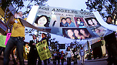 June 03, 2009; Santa Monica, CA - Supporters march through Third Street Promenade during a candlelight vigil for Euna Lee and Laura Ling, two American journalists who have been detained in North Korea for nearly three months...Photo Credit: Darrell Miho