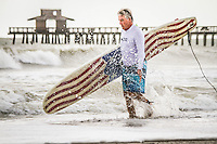 Surfer 'dude' checks out Gulf of Mexico waves at historic Naples Fishing Pier after Isaac moves away from Southwest Florida, Aug. 27, 2012 ... photo by Debi Pittman Wilkey