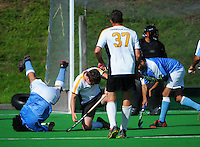Action from the Wellington Premier Two men's hockey grading match between Harbour City 2 (white, yellow and black) and Indians 3 (light blue) at National Hockey Stadium, Wellington, New Zealand on Sunday, 12 April 2015. Photo: Dave Lintott / lintottphoto.co.nz