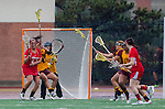 Los Angeles, CA 02/28/14 - Nina Kelty (USC #47), Jackie DiMaria (Marist #11) and Liz Shaeffer (USC #11) in action during the Marist Red Foxes vs University of Southern California Trojans NCAA Women's lacrosse game at Loker Track Stadium on the USC Campus.  Marist defeated USC 12-10.