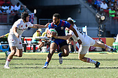 3rd February 2019, Spotless Stadium, Sydney, Australia; HSBC Sydney Rugby Sevens; England versus USA Mens semi final; Maceo Brown of the United States of America tries to go between the tackles of Ethan Waddleton and Will Edwards of England