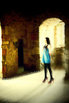 Woman standing in empty room of old building