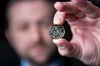 Tuesday 28 February 2017<br /> Pictured: Scott Kuperus, The Royal Mint's technical managerwith  the new one pound coin <br /> Re: The Royal Mint in Llantrisant is producing the new one pound coin