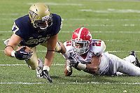 Youngstown State Cornerback Dale Peterman tackles Pitt receiver Mike Shanahan (87). The Youngstown St. Penguins defeated the Pittsburgh Panthers 31-17 on Saturday, September 1, 2012 at Heinz Field in Pittsburgh, PA.