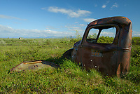 Abandoned truck used by the Alaska Road Commission along the Kougarok Road, north of Nome, Alaska. Photo by James R. Evans