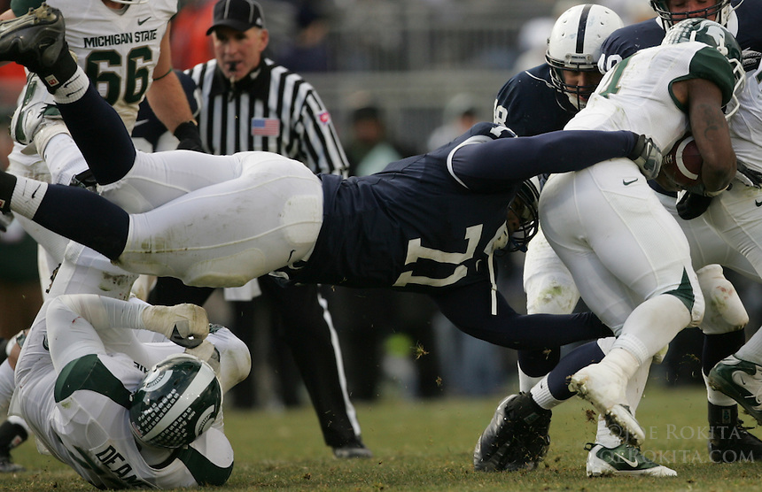 State College, PA - 11/27/2010:  DT Devon Still (71) dives to tackle the MSU ballcarrier.  Penn State lost to Michigan State by a score of 28-22 on Senior Day at Beaver Stadium...Photo:  Joe Rokita / JoeRokita.com..Photo ©2010 Joe Rokita Photography
