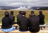 AJ3572, Old Faithful, Yellowstone National Park, geyser, amish, Wyoming, Yellowstone, A group of Amish sit on benches waiting to watch The Old Faithful Geyser erupt in Yellowstone National Park in the state of Wyoming.