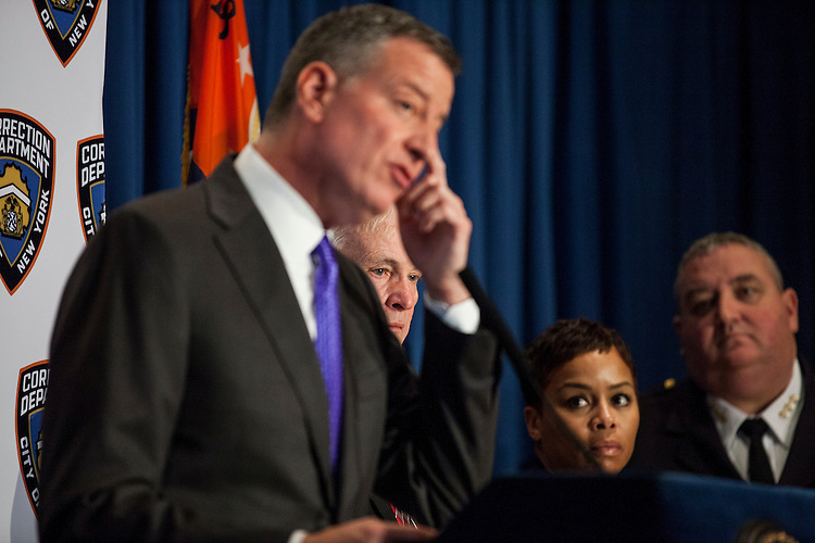 New York City Mayor Bill De Blasio pays a visit to Rikers Island to briefly tour the facilities and lead a press conference on the heel of several reforms being implemented at the facilities by the New York City Department of Correction. Here, Commissioner for New York City's Department of Correction Joe Ponte stands by the mayor.<br /> <br /> <br /> Photographed on December 17, 2014 by Mark Abramson for the Wall Street Journal